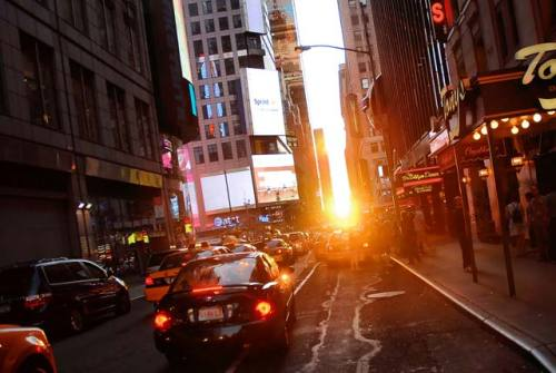 "siddman:  Manhattanhenge Rises This Monday!: Gothamist   New Yorker's favorite urban phenomenon is almost upon us—the first date for Manhattanhenge 2011 is happening this Monday. And it's the perfect excuse to head into the abyss of Manhattan this Memorial Day weekend! The visually stunning event occurs twice a year, when the sun sets in perfect alignment with Manhattan's street grid—it will fully illuminate every single cross-street for the last 15 minutes of daylight. It will take place on Monday at 8:17 p.m. according to astrophysicist Neil deGrasse Tyson. There will also be a half-sun effect on Tuesday at 8:25 p.m. The second date this year will take place on Monday, July 11 at 8:25 p.m., and there will be a half-sun on Tuesday July 12 at 8:25 p.m. NY Daily News photographer John Taggert, gave some tips for Manhattanhenge enthusiasts who want to capture the event: ""[Manhattanhenge] passes by very quickly, so you'll want to set a high aperture of about 11, a shutter speed of 1/2500 of a second, and shoot the sun from an overpass…the sun is moving quickly; you have to keep shooting until it's perfectly centered between the buildings."" For newcomers to the event, he suggests you position yourself as far east in Manhattan as possible, while making sure when you look west across the avenues you can still see New Jersey. Ideal streets include 14th, 23rd, 34th. 42nd, and 57th."