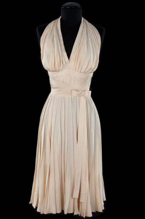 "emmicamille:  The dress worn by Marilyn Monroe in The Seven Year Itch is probably one of the most famous and instantly recognizable dresses in history both in film and fashion.   ""I wondered what could I do with this most beautiful girl that  Marilyn was to play to make her look clean, talcum-powdered, and  adorable"" said costume designer William Travilla of the idea behind his iconic creation.  It's going up for sale in a few weeks so it could be yours if you happen to have a million or so lying around, although I really hope  this ends up in a museum for everyone to enjoy."