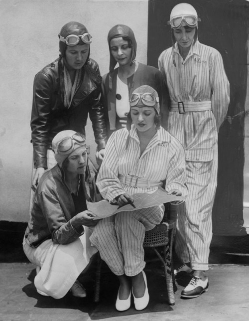 coolchicksfromhistory:  Famous women pilots preparing to take part in the 1934 Memorial Day air races at Dycer Airport. In front row kneeling is Gladys O'Donnell, who last year entered seven races and won six. Seated is Ruth Elder, famous flying beauty. Standing left to right: Kay Van Doozer, Myrtle D. Mims and Clema Granger.
