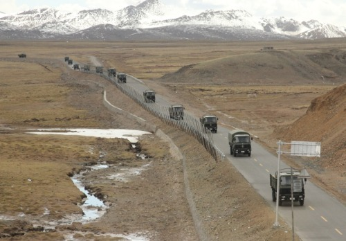 military vehicles, somewhere in Tibet