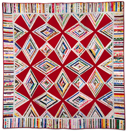 "jbe200quilts:  The Red Zinger by Karen Griska Machine quilted. [ 62"" x 62"" ] This lively quilt was made for Mark Lipinski's Quilter's Home magazine, Sept/Oct 2008 issue.  Karen also authored Quilts from the Selvage Edge. For free, simple instructions on how to make your own Red Zinger quilt, visit www.selvageblog.blogspot.com. Also visit Karen's website: www.selvagequilts.com, and her Empire Quilters Quilter of the Month page."