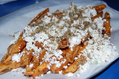 Greek Fries Cooked well and topped with feta, oregano, salt, and pepper.
