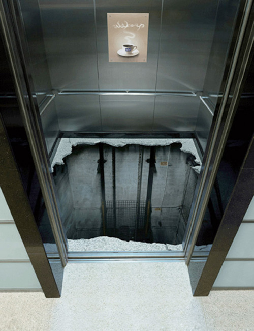 "How would you love to open an elevator to see this on the floor. It's actually a sticker placed on the floor as part of a advertisement campaign by the Maxwell House Morning Alarm coffee company who tells you to ""Wake up"" Alexandar Wagner - That's What It Cool gkstudioproductions.com Maxwell House: Morning Alarm coffee company"
