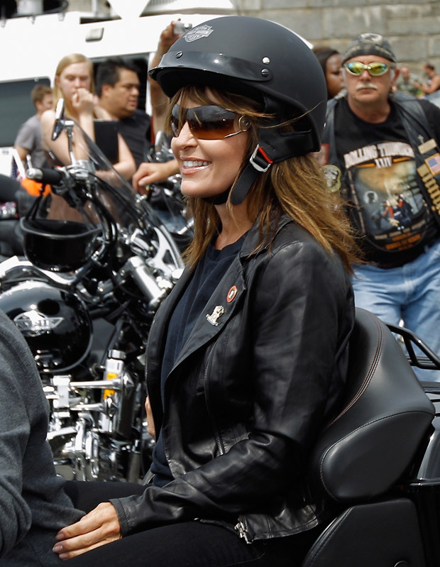"Sarah Palin rides on a motorcycle before participating in the ""Rolling  Thunder"" rally May 29, 2011 in Arlington, Virginia."