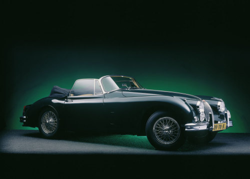 "goodoldvalves:  Jaguar XK150 DHC (1950) The successor of the XK140. ""Although having a family resemblance to the XK120 and XK140, the XK150  was radically modernised. For the first time a one piece windscreen was  used and the wing line no longer dropped as much over the doors. The  bonnet was widened and opened down to the wings and on the OTS the  bulkhead was moved back to make it about 4 inches longer. The standard engine, the same as fitted to the XK140, was the 3.4 litre  DHC Jaguar straight-6 rated at 180 bhp at 5750 rpm but most cars were  fitted with the SE engine that had a modified cylinder head with larger  exhaust valves rated at 210 bhp at 5500 rpm."" — source"