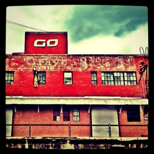 This vacant industrial building has not only a #ghostsign on it, but a yellow coat hanging from one of its windows.  #awesome (Taken with instagram) Subsequent note: In recent years, at least one club has operated out of the building (which could help explain the presence of the coat!). The warehouse is located at 2001 Commerce Street — within shouting distance of Minute Maid Park — east of downtown Houston. Thanks to a Google search, I now know that Graybar Electric Company was formerly housed in the building. The company's old logos jibe with the ghost sign's faded paint. See history.graybar.com/1942-1964.php and history.graybar.com.