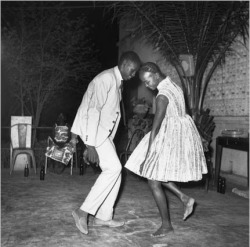 two people dancing - a photograph by malick sidibe