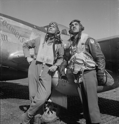 "Col. Benjamin O. Davis and Edward C. Gleed in Ramitelli, Italy in March 1945. Col. Davis was the Commanding Officer of the 332nd Fighter Group - the Tuskegee Airmen. Mr. Gleed was Group  Operations Officer. P-5/D, ""Creamer's Dream,"" is in the background.  Photo by Toni Frissell."