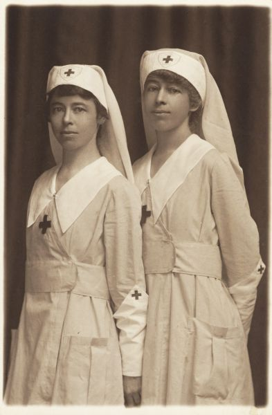 1918 photograph of two Red Cross nurses in Madison, WI. They were stationed with a mobile Red Cross unit in Europe during WWI.