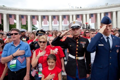 A Marine and a U.S. Airman join guests at a 2008 Memorial Day service at Arlington National Cemetary.