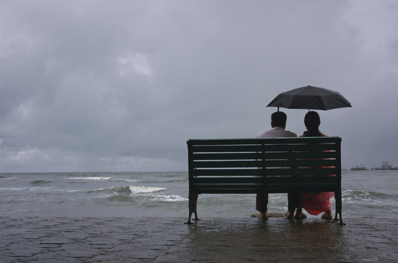 Photos of the day A couple rests on a seaside promenade during a rain shower in the southern Indian city of Kochi May 29, 2011. India's annual monsoon rains are expected to arrive on its southern coast around May 31, on schedule, despite expectations of its delayed onset over the Andaman, the India Meteorological Department reported. (Sivaram V./Reuters)