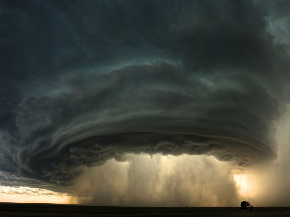 Montana Thunderstorm Photo and Caption by Sean Heavey A supercell thunderstorm rolls across the Montana sunset prairie at sunset.