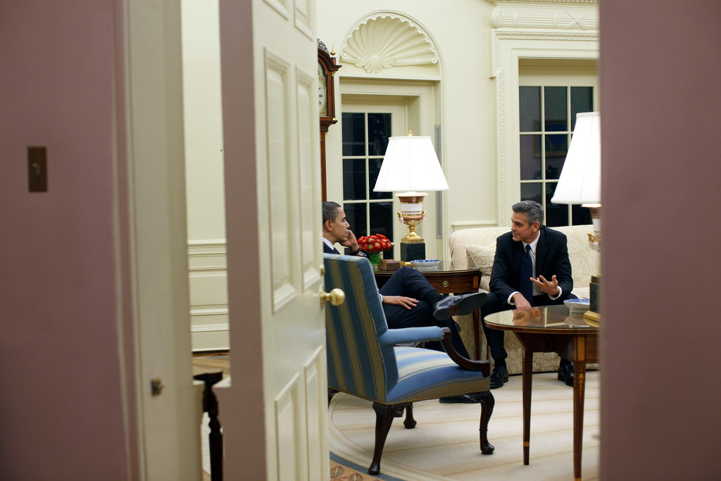 Barack Obama and George Clooney in the Oval Office