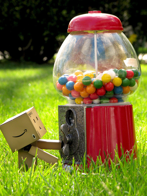 Danbo & the Gumball Machine This shot of Amazon.co.jp mascot, Danboard, comes from Flickr user Yoshi Gizmo. The figure is part of Revoltech's line and even has some light-up eyes when you flip a switch. Yoshi Gizmo takes a lot of photos featuring Japanese toys, so take a look at here Photostream.