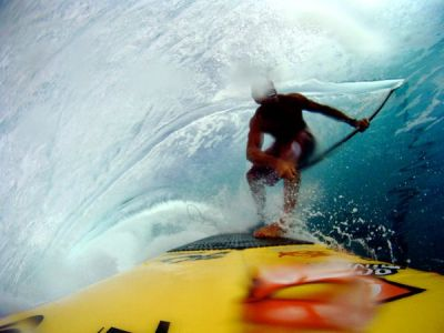 "Extreme Photo of the Week: Stand Up Paddle Surfing in Tahiti ""I had surfed and tow surfed here before,"" says big-wave surfer Chuck Patterson about Teahupo'o, a renowned surf spot Tahiti. ""But I always wondered what it would feel like to get tubed on my stand up paddle surf board—this is what I came for."" The water is sucked off a shallow, razor sharp reef, making the barrel break below sea level. ""This wave is incredibly challenging to paddle into, let alone surf,"" notes Patterson. ""Any mistakes could be costly."" The photograph was taken by a camera mounted to his board. Photograph by Chuck Patterson"