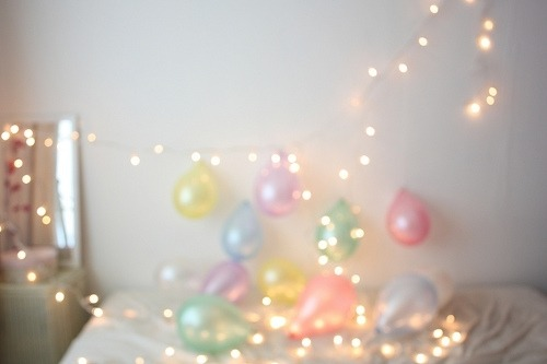Christmas lights and pastel-colored balloons.