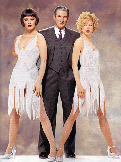 Richard Gere, Renee Zellweger and Catherine Zeta-Jones in an unknown magazine in costumes they wore in Chicago (2002), designed by Colleen Atwood, 1920's I really wish Chicago had more accurate costumes, but nobody care what I think.