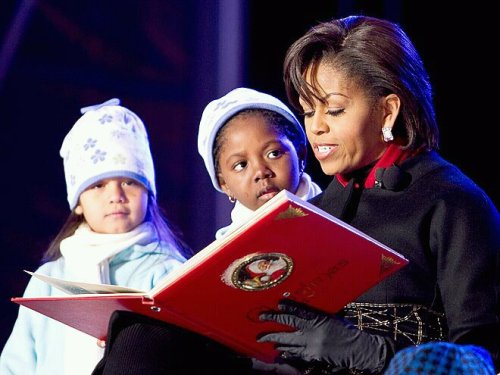 This photo amazes me! Of course it is just a picture of Michelle Obama reading a book and two little girls sitting by her side but it is just that one girl who stares at Michelle Obama. She is not looking out into the crowd if there is one, or is not looking down at the book but her expression is of interest in Michelle Obama. I wonder what did the young girl see as she sat there and looked at Michelle. A picture like this, I see it as beauty of a young beautiful girl looking up at one of her inspirations & heroes of today. What do you see?? Share with me.