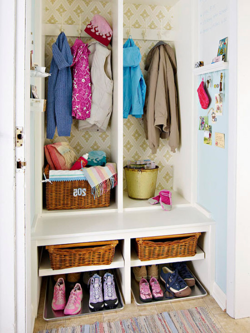 A closet with doors removed to build in cubbies. From Better Homes & Gardens