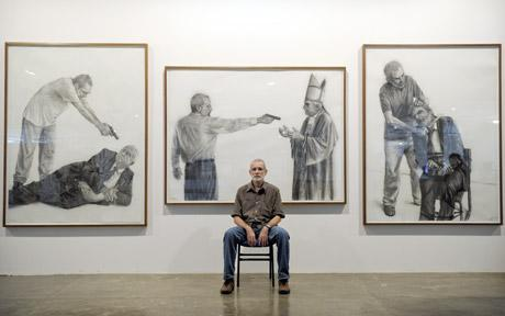 Brazilian artist Gil Vicente with his paintings. (Telegraph)