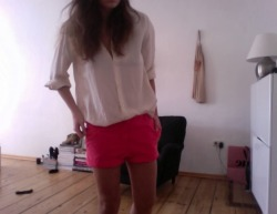 I'm so in love with my electric pink shorts from Zara. I team them with a silk shirt from Filippa K. A.