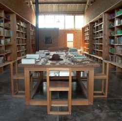 "Donald Judd's Library in Marfa, Texas.  Image courtesy of Judd Foundation. ""Assorted pornography, native plants and the Cold War are among the subjects that fill the library of the artist Donald Judd (1928-1994). But you don't have to travel to Marfa, Tex., to browse the shelves. Today, Web visitors can click on a floor plan of his two-room library to view the 13,004 volumes arranged exactly as Judd arranged them. The virtual library has been rendered so faithfully that visitors navigate furniture and art designed by Judd and glimpse an artwork by Dan Flavin between the custom bookcases. Construction of the virtual library required 672 photographs of the interior, along with custom software designed by Ryan Tainter. Even Judd's notes on how he was going to catalog the arts section (by dates of birth and death) are included. Clicking on a spine calls up the book's Library of Congress details and a physical description. And while the books cannot be checked out, Tainter's program links to WorldCat and lists lending institutions near the browser where each book is available for loan."" — Shonquis Moreno, ""One for the Books: Inside Donald Judd's Library"", The New York Times, May 26, 2010.  via: bellswithin"