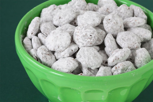 "watchmedo:  Sweet things are my weakness and I LOVE puppy chow!  I think I might try this using PB2 as a sub for peanut butter undressedskeleton:  Kitty Chow! Calories- 100 Total Carbs- 18 Fat -2g Fiber-5g Protein- 2 You know that Puppy chow stuff that is really yummy!? Well it's also 365 calories a cup! So here is my version but its only 100 calories! Makes 4 Servings Ingredients: 2 Cups Fiber one Honey Squares 4 Tablespoons ""I can't believe it's not butter"" 2 Tablespoons Creamy All Natural Peanut Butter 2 Servings Truvia all Natural Sweetener. 1 Package of Fat Free Sugar Free Vanilla Pudding Mix 2 Squares of Reduced Fat Chocolate Almond Bark Directions In a large mixing bowl melt butter, chocolate almond bark and  peanut butter. (I used the microwave) After melted pour cereal into mixture. Stir gently Let the mixture cool for a good 20 minutes. After mixture has hardened pour the mix into a large zip lock bag, add the box of pudding mix and shake gently until coated."