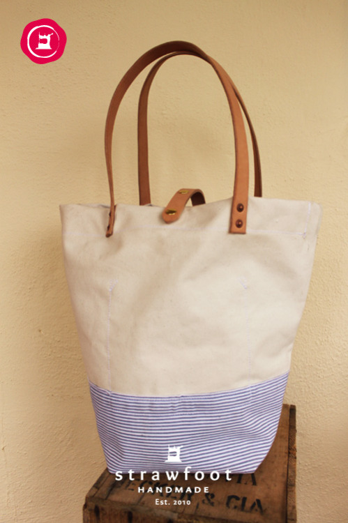 strawfoot:  New ladies beach bag, now available at Stripe in Santa Cruz. Natural USA 15oz duck canvas with vintage cotton ticking fabric bottom and inner pocket. Veg. tanned straps and snap closure.