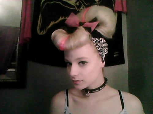 Ugh.. this will be a bitch to take out.. I made the bow. =^.^= I need a hair model :P This is where i learn my hair tips: http://www.youtube.com/user/LisaFreemontStreet