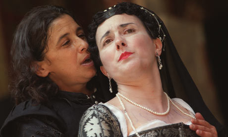 Kathryn Hunter as Richard of Gloucester seducing Yolande Vasquel's Lady Anne in an all-female production of Richard III. [Image description: Close-up shot of two women, one with loose shoulder-length  dark hair and in black Renaissance male attire, wearing little to no  makeup, leaning seductively toward the other, who wears a long dark veil over  carefully dressed black hair and a low-cut black and silver dress along with a  string of pearls and obvious makeup. The woman in traditionally female attire looks distressed.] (Submitted by meganphntmgrl.)