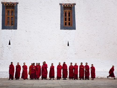 Someone had to go, badly.    Monks, Bhutan Photograph by Gaston Lacombe This Month in Photo of the Day: Traveler Contest Images At the Dzong in Punakha, Bhutan, a young monk breaks rank during a ceremony. (via Monk Picture – Bhutan Photo - National Geographic Photo of the Day)