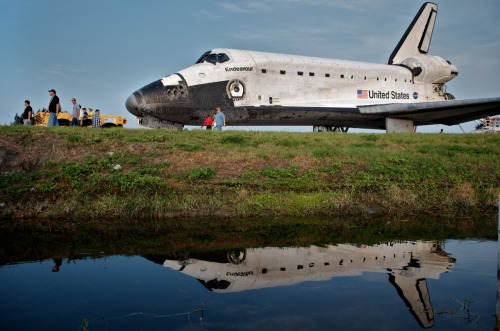 "nationalpost:  Shuttle Endeavour returns after final missionThe space shuttle Endeavour touched down at its Florida home base early on Wednesday, capping a 16-day mission to deliver a premier science experiment to the International Space Station on NASA's next-to-last shuttle flight.""Your landing ends a vibrant legacy for this amazing vehicle that will long be remembered. Welcome home, Endeavour,"" astronaut Barry Wilmore radioed to Kelly from NASA's Mission Control in Houston.""It really is an incredible ship,"" Commander Scott Kelly replied. ""It's sad to see her land for the last time but she really has a great legacy.""Photo: Space Shuttle Endeavour is escorted back to a storage building following it's last mission before being retired, at Kennedy Space Center, on June 1, 2011, in Cape Canaveral, Florida. (Roberto Gonzalez/Getty Images)"