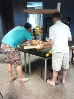 Sometimes you just gotta trim the legs of your ping pong table, at the office, in your flip flops. Related: Our table is regulation height now!