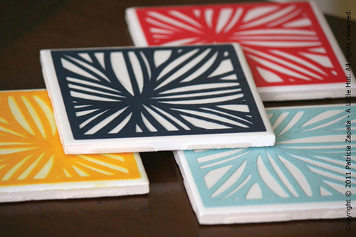 DIY Coaster Set I have a small obsession with coasters…not that I have a lot but I do find myself collecting an absurd number of ideas, patterns and tutorials for them!  I fell in love with this idea from A Little Hut to use tiles and mod podge.  Aren't they just lovely? While you are there, be sure and check out the other fun tutorials!
