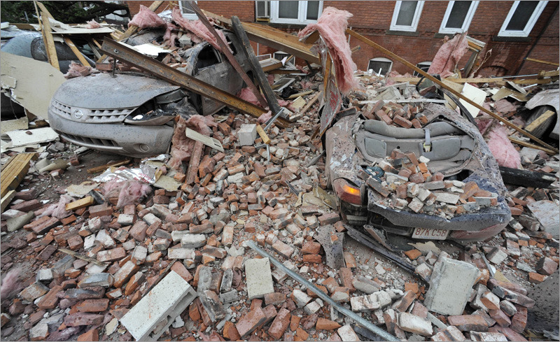 Bricks and debris that fell from a building lay on top of cars after a report of a tornado in Springfield, Mass.  » more photos (AP Photo/Jessica Hill)