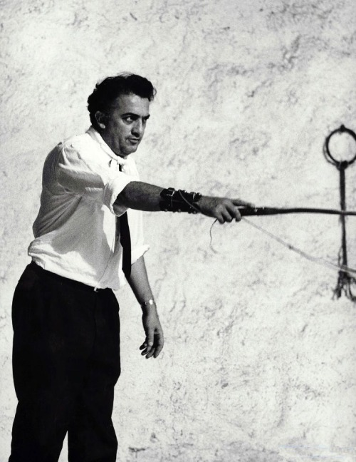 "oldhollywood:  Federico Fellini on the set of 8½ (1963). Photo by Tazio Secchiaroli ""I discovered that what's really important for a creator isn't what we vaguely define as inspiration or even what it is we want to say, recall, regret, or rebel against. No, what's important is the way we say it.  Art is all about craftsmanship. Others can interpret craftsmanship as style if they wish. Style is what unites memory or recollection, ideology, sentiment, nostalgia, presentiment, to the way we express all that. It's not what we say but how we say it that matters."" (via)"