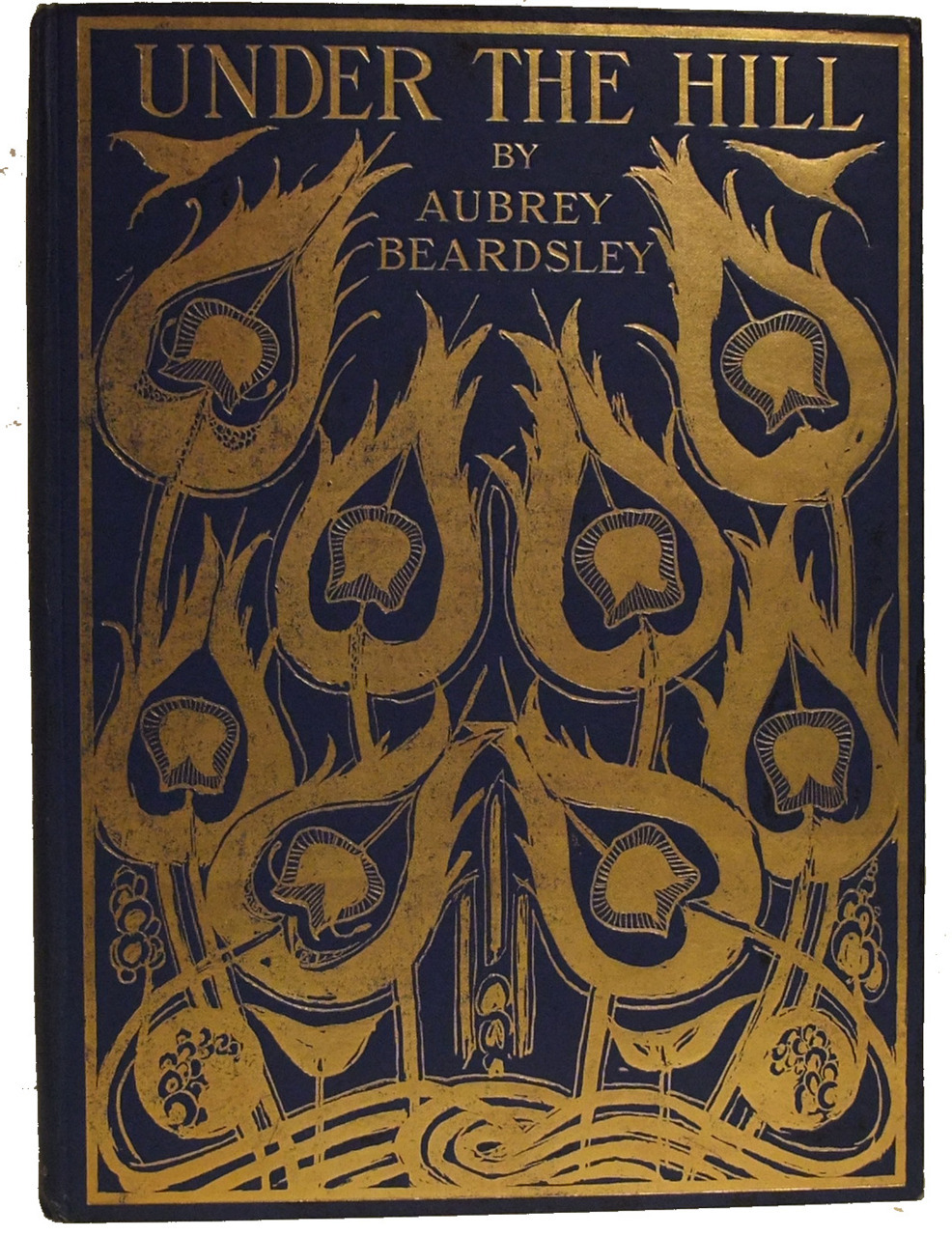 Aubrey Beardsley ~ Book Cover ~ Under the Hill and Other Essays ~ via BEARDSLEY, AUBREY: Under the Hill and Other Essays in Prose and Verse. London: John Lane 1904. Illustrations with tissue guards. 4to. 70, [4, ads] pp. Publisher's blue cloth, with gilt design by Beardsley.
