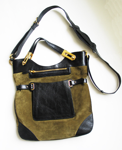 Balenciaga bag on eBay. I didn't like it upon first glance but the colour combination is growing on me. Bidding is currently at $299 here.