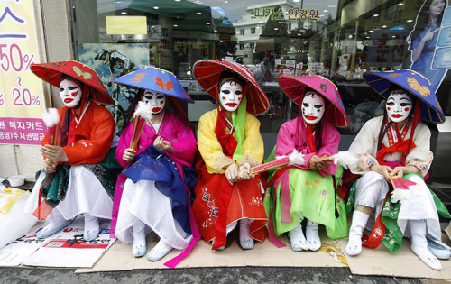Prostitutes in Chuncheon, South Korea, wearing traditional costumes attend a protest against a police crackdown on brothels Photograph: Lee Jae-won/Reuters (via guardian.co.uk)