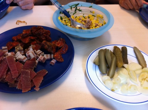 today's lunch at the office: slovakian chili sausage, raw ham and bacon, all smoked and home made.