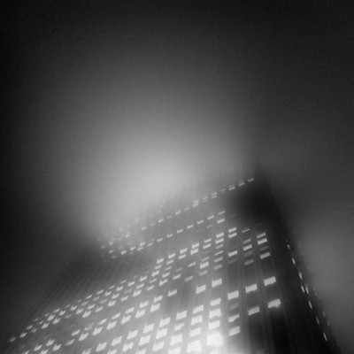 #misty #skyscraper #night #lights #building #architecture #structure #mist #blackandwhite #monochrome (Taken with instagram)