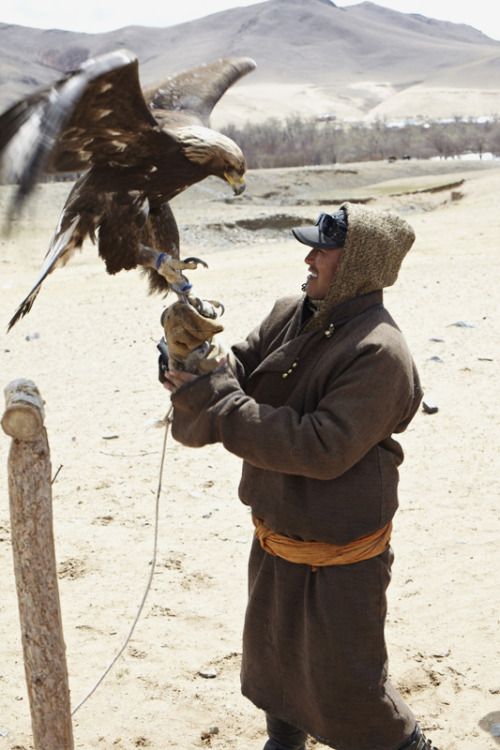 Man and bird, Mongolia, May 2011. by Andrea Fazzari