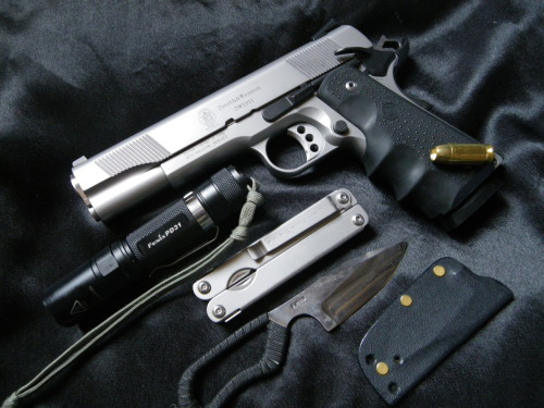 everydaycarry: submitted by Nicolas -Fred Perrin Neck Bowie -Sw 1911 .45 acp -Fenix PD 31 flashlight -Leatherman Sideclip Editor's Note: Much heavier on the tactical spectrum of things, but it's very functional and the gear is well-chosen. I especially like the clipped Leatherman. Thanks for sharing.