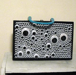 Transform an old purse with googly eyes!