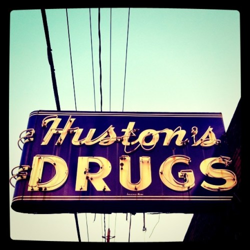 I love this vintage sign. The building — the old drug store — was shuttered several years ago. If you look through the building's front windows, you can see merchandise inside, scattered on shelves, countertops, and atop the soda fountain. Did the former occupant leave in a hurry, and never return? A mystery. (Taken with Instagram at 2119 Washington Avenue, in Houston)