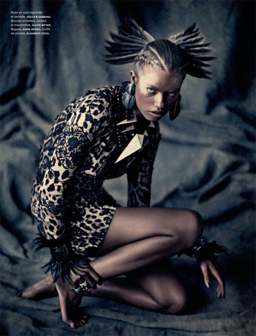 Dolce & Gabbana's tribal gathering in Numero 124 for Spring 2011 The tribal trend is always a favourite look.  The accessories and embellishments you can work into an outfit are vast with head-dresses, cuffs, huge earrings, thick chokers & anything you can feather.  This tribal lookbook shoot in Numero 124 will definitely give you an updated taste of the tribal look fit for Spring 2011.  Shot by Sebastian Kimwith stylist Charles Varenne and model Hailey Clauson. This look:  Dolce & Gabbana dress, Alexis Bittar earrings, cuffs & necklace, Eddie Borgo rings, Elisabeth Koch feather headdress See the complete tribal fashion shoot with Sebastian Kim, Hailey Clauson & Charles Varenne in Numero 124