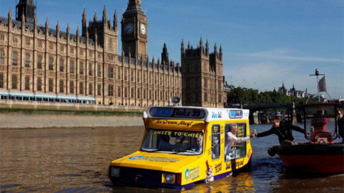 "The world's first amphibious ice cream truck debuts in the UK Yes, this is just a PR stunt from Cadbury, but for fuck's sake, it's an amphibious ice cream truck that floats back and forth down the Thames playing Rod Stewart's ""We Are Sailing"" and giving out ice cream to whoever swims or floats out to the truck. That's #winning. Via"
