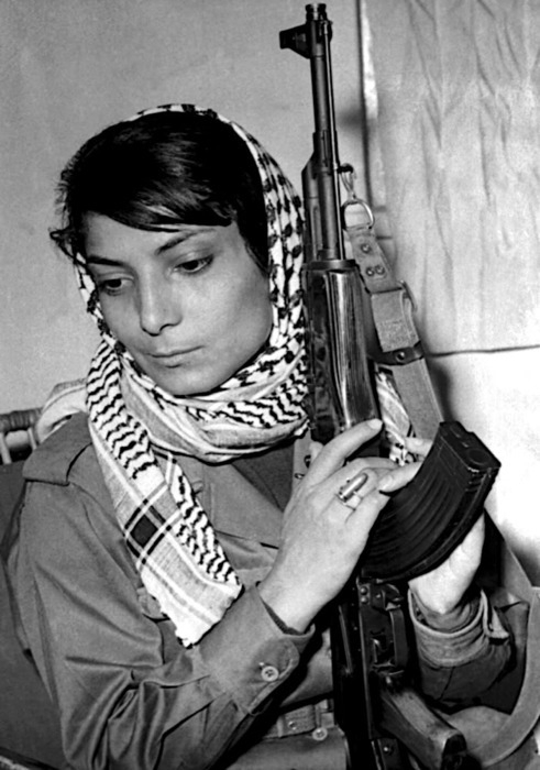"zuky:  sunekdokhe:bonjour-habibti:   ""The iconic photograph of Leila Khaled, the picture which made her the symbol of  Palestinian resistance and female power, is extraordinary in many ways: the gun  held in fragile hands, the shiny hair wrapped in a keffiah , the delicate Audrey  Hepburn face refusing to meet your eye.""(The Guardian - 26 January 2001)  Alright, I got a bone to pick with this caption. Stop me if you've heard this one before. Leila Khaled, for whatever anyone may say about her, is a fighter. And I have some issues with the way that female fighters are talked about versus the way that their male counterparts are talked about. Women are not allowed to be viewed as fighters, as revolutionaries, and as human beings. And the fact that this caption shows up with this image and people don't critically take on the language we use to talk about women in war, women in revolutions, women in armed struggle, is really, really interesting to me. I don't know how the image and the text were paired up. All I know is while I agree with the assessment of female power, I see nothing 'fragile' about the hands that clasp that gun. I see nothing 'delicate' in her face and I certainly don't channel Audrey Hepburn when gazing at this picture. I don't feel the need to talk about Khaled's inherent fragility and delicateness in, what, a need to water her and her actions down, make them a little more palatable? I don't need to liken her to film actresses so that it almost seems as if we should be viewing her as a role-player, rather than a revolutionary. I've written extensive papers on women of the Basque separatist movements and how  they were viewed by the Spanish media. They were often discussed in terms of their menstrual cycles, the blood  they shed for their political beliefs linked irrevocably to the blood  they shed as 'delicate women'. They often took the roles of messengers where sexism actually helped them move about more efficiently, since a woman could never be a rebel. They were allowed access to prisoners and could diffuse information to their separatist comrades. They were discussed only in terms of maternity and while motherhood is certainly a radical concept in and of itself, Spanish media constantly harped on the political subverting these women, making them non-women. If you can't lighten up their image with commentary on their fragile hands and delicate faces, better make them 'not-women'. The discourse surrounding woman revolutionaries is vastly different from the way males are. And as someone who is often read as female and who wants to be known for the political work they put out there, knowing that much will be made of my small hands or my menstrual cycle at the expense of my politics, my ideals, and my struggle infuriates me. Unless this was the interpretation Leila Khaled wanted to be attached to this image, I'm seriously unimpressed. I'm unimpressed that no mention is made of what she did, only what she looks like.  True. It is very annoying, and The Guardian quote up above is a very shitty description of this photo. I don't know who wrote it but I know the lens being applied is a white male lens, which tends to automatically place women in a sexualized context of femininity or lack thereof, no matter what other cultural contexts are being visually represented or addressed in immediately relevant discourse. Thus, no matter what a woman is pictured doing, her hands are deemed either ""fragile"" or ""mannish"", her hair either ""shiny and flowing"" or ""unkempt"", her features either ""delicate"" or ""rugged"", and so on, creating an elaborate code language by which the white male lens is actually merely rating the desirability of its subject, necessarily according to its own racist sexist politicized standards, even as it feigns a posture of universal objectivity. Regarding this particular photo, the fragile delicate Audrey Hepburn eyes-averted lingo seems to be an over-reaching expression of surprise and approval that a Palestinian freedom fighter has achieved a high rating. That's the subject of discussion, not the substance of the actual freedom fight in which she is engaged."