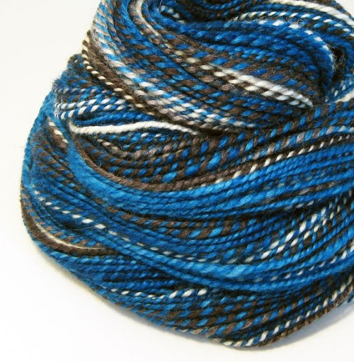 doctorbluebox:  troispommesvertes:  (via Handspun Yarn Tardis 120 Yards by valentinearts on Etsy) Tardis yarn! Awesome!  I severely regret never learning how to knit!!!  Idk how to knit but if you buy this I can crochet you a scarf or something.  :)