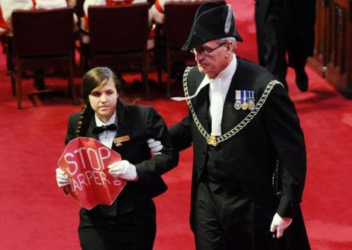 "Photo of the day: A Canadian senate page disrupted Stephen Harper's first throne speech under a Conservative majority with a ""Stop Harper"" sign. This girl (who we've heard called Brigette Marcelle and Brigette DePape) is bold and a total badass for pulling this off. She may have gotten fired for this mess, but she has our respect. (Pic by Sean Kilpatrick, The Canadian Press)"